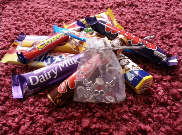 Photo of pirate necklace and candy won by a reader in my recent giveaway